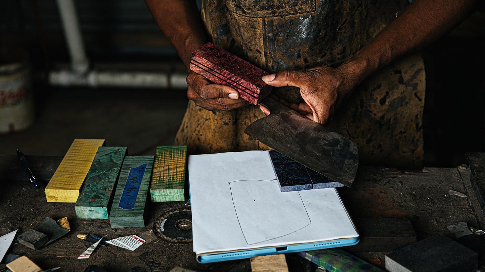 Man making knife